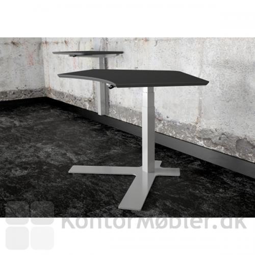 Antracitgrå linoleumsplade på enkeltsøjlet hæve sænke bord- i baggrunden vægmonteret