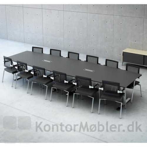 Stort to-delt konferencebord med overflade i antracitgrå laminat og forkromet stel