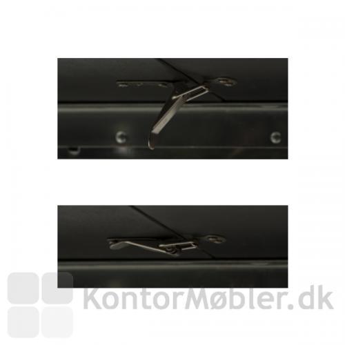 Eclipse udtræksbord har små låse under bordet, så forlængerpladerne ligger fast