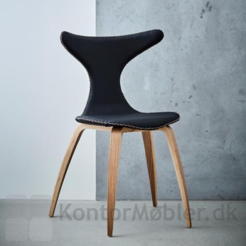 Dolphin stolen med ben i egefinér og polstret med sort kunstlæder