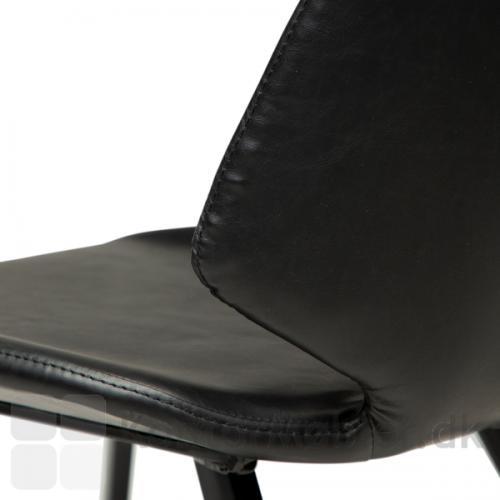 Swing restaurantstol i sort vintage kunstlæder, med lille vinge på ryglænet