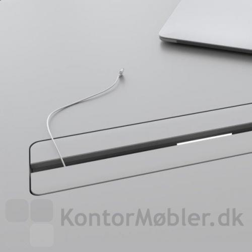 Den dobbelte kabelgennemføring er yderst diskret, når den er lukket